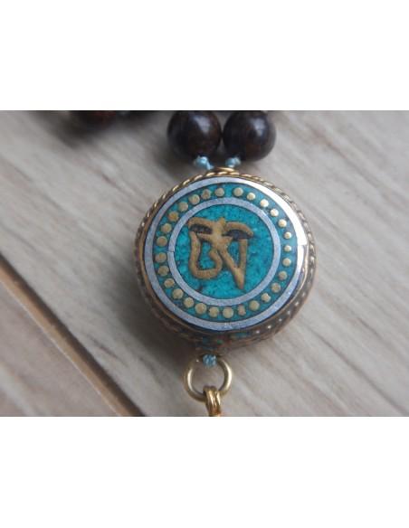 Sautoir en bronzite, perle Om et pompon vermeil