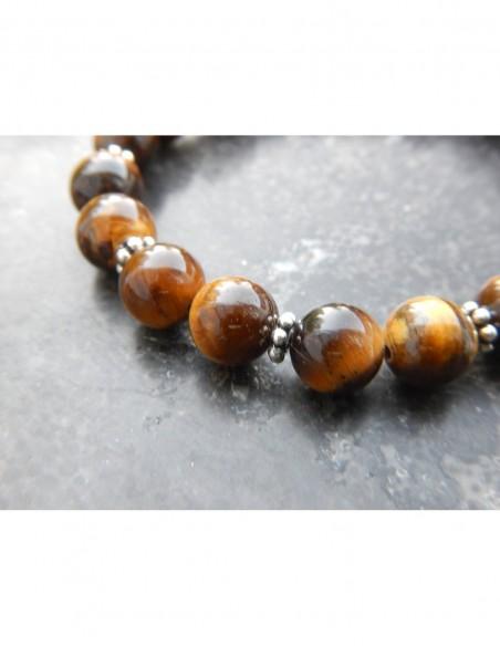 Bracelet oeil de tigre, médaille Aum et perle bouddha