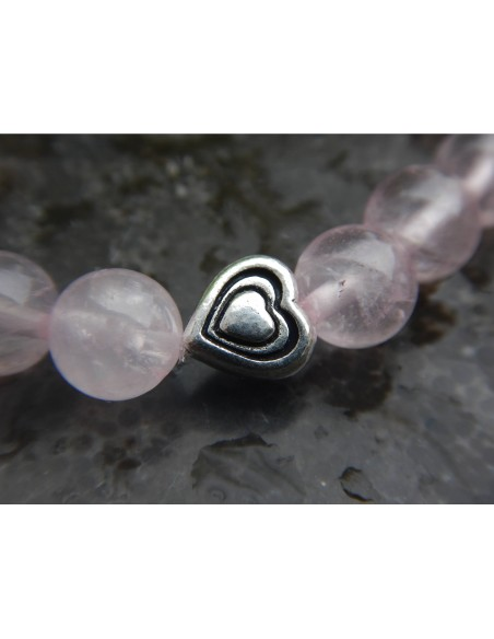 Bracelet enfant en pierres naturelles de quartz rose, perles de 8 mm et sa perle coeur en métal argenté haute qualité.